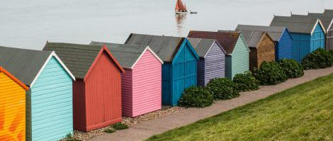 beach huts and a yacht in Herne Bay, Kent, uk