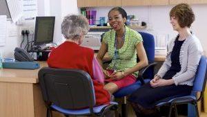 GP practice staff with patient